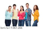 Купить «group of smiling teenagers showing triumph gesture», фото № 7067266, снято 22 июня 2014 г. (c) Syda Productions / Фотобанк Лори