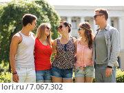 Купить «group of smiling friends outdoors», фото № 7067302, снято 20 июля 2014 г. (c) Syda Productions / Фотобанк Лори