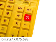 Желтый калькулятор с красной кнопкой. Стоковое фото, фотограф Максим Буданов / Фотобанк Лори
