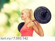 Купить «smiling sporty woman exercising with barbell», фото № 7093142, снято 8 мая 2014 г. (c) Syda Productions / Фотобанк Лори