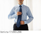 Купить «close up of man in shirt adjusting tie on neck», фото № 7093298, снято 13 ноября 2014 г. (c) Syda Productions / Фотобанк Лори