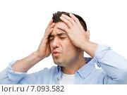 Купить «unhappy man with closed eyes touching his forehead», фото № 7093582, снято 3 февраля 2015 г. (c) Syda Productions / Фотобанк Лори