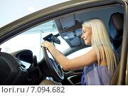 Купить «happy woman inside car in auto show or salon», фото № 7094682, снято 22 января 2015 г. (c) Syda Productions / Фотобанк Лори