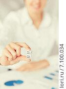 Купить «man hands with gambling dices signing contract», фото № 7100034, снято 24 апреля 2013 г. (c) Syda Productions / Фотобанк Лори
