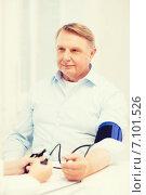 Купить «female doctor or nurse measuring blood pressure», фото № 7101526, снято 12 октября 2013 г. (c) Syda Productions / Фотобанк Лори