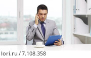 Купить «businessman with tablet pc calling on smartphone», видеоролик № 7108358, снято 6 февраля 2015 г. (c) Syda Productions / Фотобанк Лори