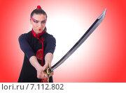 Купить «Woman in japanese martial art concept», фото № 7112802, снято 7 мая 2013 г. (c) Elnur / Фотобанк Лори