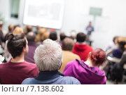Купить «Люди в аудитории слушают лекцию», фото № 7138602, снято 4 апреля 2020 г. (c) Matej Kastelic / Фотобанк Лори