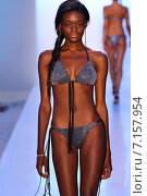 Купить «MIAMI, FL - JULY 20: A model walks the runway at the Belusso during MBFW Swim 2015 at The Raleigh hotel on July 20, 2014 in Miami, FL.», фото № 7157954, снято 20 июля 2014 г. (c) Anton Oparin / Фотобанк Лори