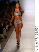 Купить «MIAMI, FL - JULY 21: A model walks the runway at the Aquarella during MBFW Swim 2015 at The Raleigh hotel Center on July 21, 2014 in Miami, FL.», фото № 7158054, снято 21 июля 2014 г. (c) Anton Oparin / Фотобанк Лори
