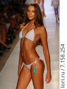 Купить «MIAMI, FL - JULY 20: A model walks the runway at the Caffe Swimwear during MBFW Swim 2015 at The Raleigh hotel on July 20, 2014 in Miami, FL.», фото № 7158254, снято 20 июля 2014 г. (c) Anton Oparin / Фотобанк Лори