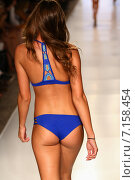 Купить «MIAMI, FL - JULY 20: A model walks the runway at the Caffe Swimwear during MBFW Swim 2015 at The Raleigh hotel on July 20, 2014 in Miami, FL.», фото № 7158454, снято 20 июля 2014 г. (c) Anton Oparin / Фотобанк Лори