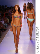Купить «MIAMI, FL - JULY 20: A model walks the runway at the Luli Fama during MBFW Swim 2015 at The Raleigh hotel on July 20, 2014 in Miami, FL.», фото № 7158754, снято 20 июля 2014 г. (c) Anton Oparin / Фотобанк Лори