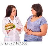Купить «Woman with hamburger and doctor.», фото № 7167506, снято 2 апреля 2012 г. (c) Gennadiy Poznyakov / Фотобанк Лори