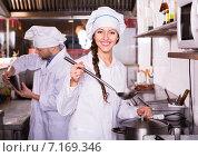 Купить «Chef and his helper at bistro kitchen», фото № 7169346, снято 21 июня 2018 г. (c) Яков Филимонов / Фотобанк Лори