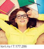 Купить «smiling student in eyeglasses lying on floor», фото № 7177286, снято 19 марта 2014 г. (c) Syda Productions / Фотобанк Лори