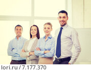 Купить «smiling businessman in office with team on back», фото № 7177370, снято 5 апреля 2014 г. (c) Syda Productions / Фотобанк Лори