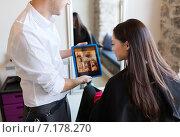 Купить «happy woman and stylist with tablet pc at salon», фото № 7178270, снято 15 февраля 2015 г. (c) Syda Productions / Фотобанк Лори