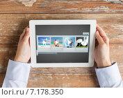 Купить «close up of hands with video gallery on tablet pc», фото № 7178350, снято 10 октября 2014 г. (c) Syda Productions / Фотобанк Лори