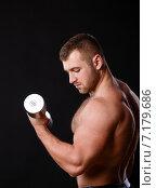 Купить «Muscular bodybuilder guy doing exercises with dumbbells isolated over white background», фото № 7179686, снято 22 марта 2019 г. (c) Александр Савченко / Фотобанк Лори
