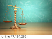 Купить «Concept of justice. Law scales on green background.», фото № 7184286, снято 16 января 2019 г. (c) Maksym Yemelyanov / Фотобанк Лори