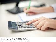 Купить «close up of woman with calculator taking notes», фото № 7190610, снято 6 ноября 2013 г. (c) Syda Productions / Фотобанк Лори