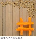 Семена и кусочки тыквы на деревянном столе. Стоковое фото, фотограф Marina Kutukova / Фотобанк Лори