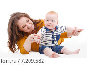 Portrait of a mother and child on a white background. Стоковое фото, фотограф Александр Савченко / Фотобанк Лори