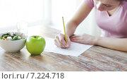 Купить «close up of young woman writing diet plan at home», видеоролик № 7224718, снято 19 марта 2015 г. (c) Syda Productions / Фотобанк Лори