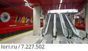 """Купить «Pictured: Rondo Daszyсskiego metro station. The Warsaw Metro consists of two lines, the north–south Line 1 that links central Warsaw with its densely populated northern and southern suburbs, and the initial segment of the east-west Line 2 that opened on March 8, 2015. In 2009, the Warsaw Metro won two """"Metro Award"""" prizes in the categories of """"Special Merit Award for Commitment to the Environment"""" and """"Best Maintenance Programme"""". These were followed by the Most Improved Metro award in 2011.», фото № 7227502, снято 8 марта 2015 г. (c) BE&W Photo / Фотобанк Лори"""