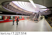 """Купить «Pictured: Plac Wilsona metro station (On 7 April 2008 during the Metrorail convention it won a Metro award for the best recently constructed station). The Warsaw Metro consists of two lines, the north–south Line 1 that links central Warsaw with its densely populated northern and southern suburbs, and the initial segment of the east-west Line 2 that opened on March 8, 2015. In 2009, the Warsaw Metro won two """"Metro Award"""" prizes in the categories of """"Special Merit Award for Commitment to the Environment"""" and """"Best Maintenance Programme"""". These were followed by the Most Improved Metro award in 2011.», фото № 7227514, снято 8 марта 2015 г. (c) BE&W Photo / Фотобанк Лори"""
