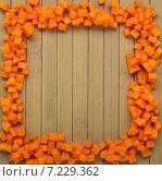 Рамка из кусочков тыквы на деревянном фоне. Стоковое фото, фотограф Marina Kutukova / Фотобанк Лори