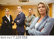 Купить «Serious lawyer standing with arms crossed», фото № 7229558, снято 7 августа 2014 г. (c) Wavebreak Media / Фотобанк Лори