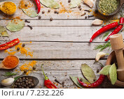 Colorful spices on a wooden background. Стоковое фото, фотограф Майя Крученкова / Фотобанк Лори