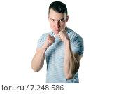 Злой человек угрожает кулаками. Стоковое фото, фотограф Петрова Инна / Фотобанк Лори