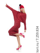 Купить «Pretty young woman in ruby dress isolated on white», фото № 7259834, снято 17 декабря 2014 г. (c) Elnur / Фотобанк Лори