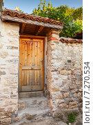Купить «Деревянная дверь и каменные стены, Несебр, Болгария», фото № 7270534, снято 21 июля 2014 г. (c) EugeneSergeev / Фотобанк Лори