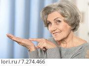 Elderly woman pointing. Стоковое фото, фотограф Ruslan Huzau / Фотобанк Лори