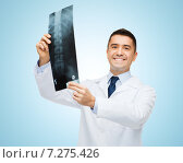 Купить «smiling male doctor in white coat holding x-ray», фото № 7275426, снято 3 февраля 2015 г. (c) Syda Productions / Фотобанк Лори