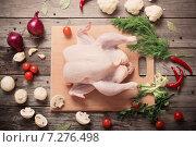 Купить «Whole raw chicken on a wooden table», фото № 7276498, снято 3 апреля 2015 г. (c) Майя Крученкова / Фотобанк Лори