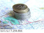 Монеты евро на итальянской карте (2014 год). Редакционное фото, фотограф Наталья Данченко / Фотобанк Лори