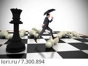 Купить «Composite image of businessman jumping holding an umbrella», фото № 7300894, снято 17 февраля 2019 г. (c) Wavebreak Media / Фотобанк Лори