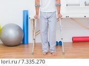 Купить «Patient standing with crutch», фото № 7335270, снято 15 января 2015 г. (c) Wavebreak Media / Фотобанк Лори