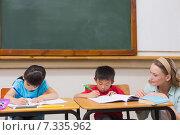 Купить «Cute pupils getting help from teacher in classroom», фото № 7335962, снято 8 ноября 2014 г. (c) Wavebreak Media / Фотобанк Лори