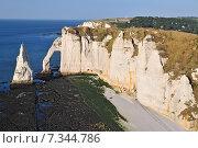 Купить «Chalk cliffs at Cote d'Albatre rocks and natural arch landmark and blue ocean in Etretat. Normandy France.», фото № 7344786, снято 18 июня 2019 г. (c) BE&W Photo / Фотобанк Лори