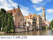 Купить «View of canal belfry and houses at Bruges Belgium.», фото № 7345218, снято 22 октября 2019 г. (c) BE&W Photo / Фотобанк Лори