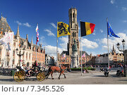 Купить «The historic belfry and city center square in the old medieval old town of Bruges (Brugge) Belgium», фото № 7345526, снято 19 октября 2018 г. (c) BE&W Photo / Фотобанк Лори