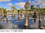 Купить «Statue at the Tirtagangga Water Palace in Bali», фото № 7345858, снято 17 декабря 2018 г. (c) BE&W Photo / Фотобанк Лори