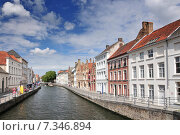 Купить «Canal and old houses in Bruges (Brugge) Belgium.», фото № 7346894, снято 16 декабря 2018 г. (c) BE&W Photo / Фотобанк Лори