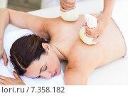 Купить «Brunette having massage with herbal compresses», фото № 7358182, снято 29 января 2015 г. (c) Wavebreak Media / Фотобанк Лори